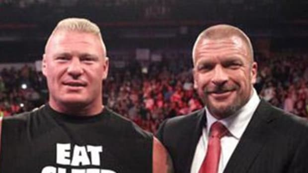 Brock Lesnar & Triple H with new WWE title belt