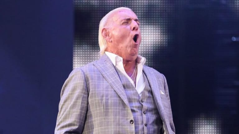 Friday Morning News Update (5/22) - Ric Flair Re-Signs With WWE, IMPACT Wrestling Stars Get Married and Kofi Kingston Says CM Punk Gave Him Advice Before WWE Debut