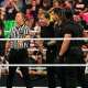 This was one of the best tag team feuds we've had in the modern era. The dynamic of this match was very strange since it was two heel teams that the crowd loved. Both teams are arguably in the high end of the best WWE factions of all time. Them facing off in a series of matches was a stand out in their careers as a team. This was at a peak point for both of these teams and it's not something I will ever forget.