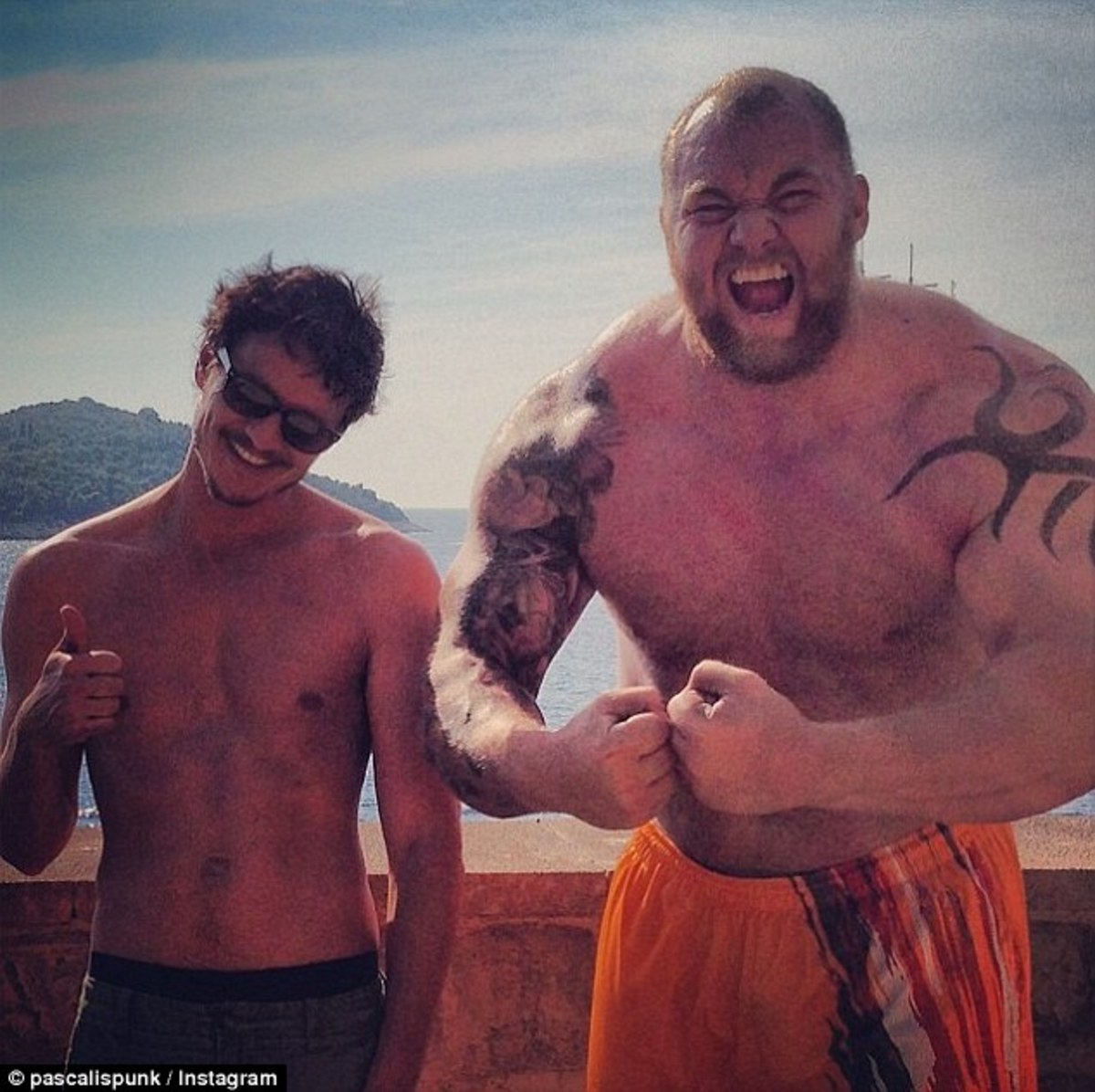 Here we have a normal sized man next to a mountain of a man (I'm good at puns)