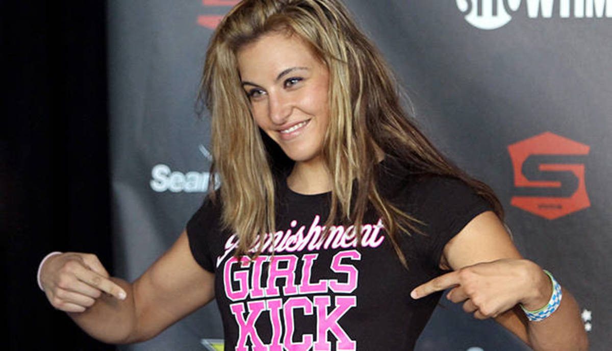 HOFFMAN ESTATES, IL - JULY 29:  Miesha Tate stands on stage at the Strikeforce: Fedor vs. Henderson weigh-in at Sears Centre Arena on July 29, 2011 in Hoffman Estates, Illinois.  (Photo by Josh Hedges/Forza LLC/Forza LLC via Getty Images)