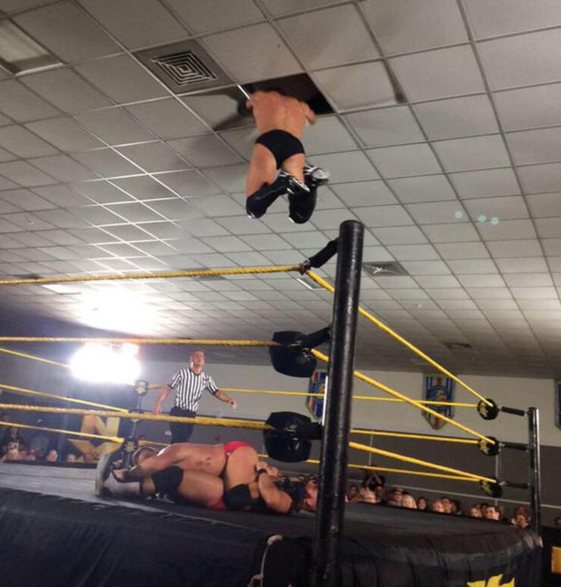 Finn Balor Through The Ceiling