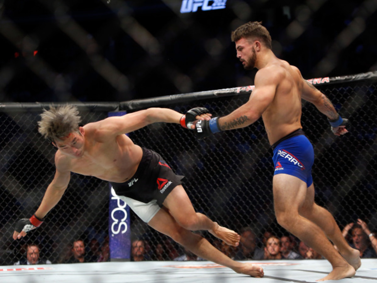 LAS VEGAS, NV - AUGUST 20:  Mike Perry (R) sends Hyun Gyu Lim to the canvas during their welterweight bout at the UFC 202 event at T-Mobile Arena on August 20, 2016 in Las Vegas, Nevada. Perry won by first-round TKO.  (Photo by Steve Marcus/Getty Images)
