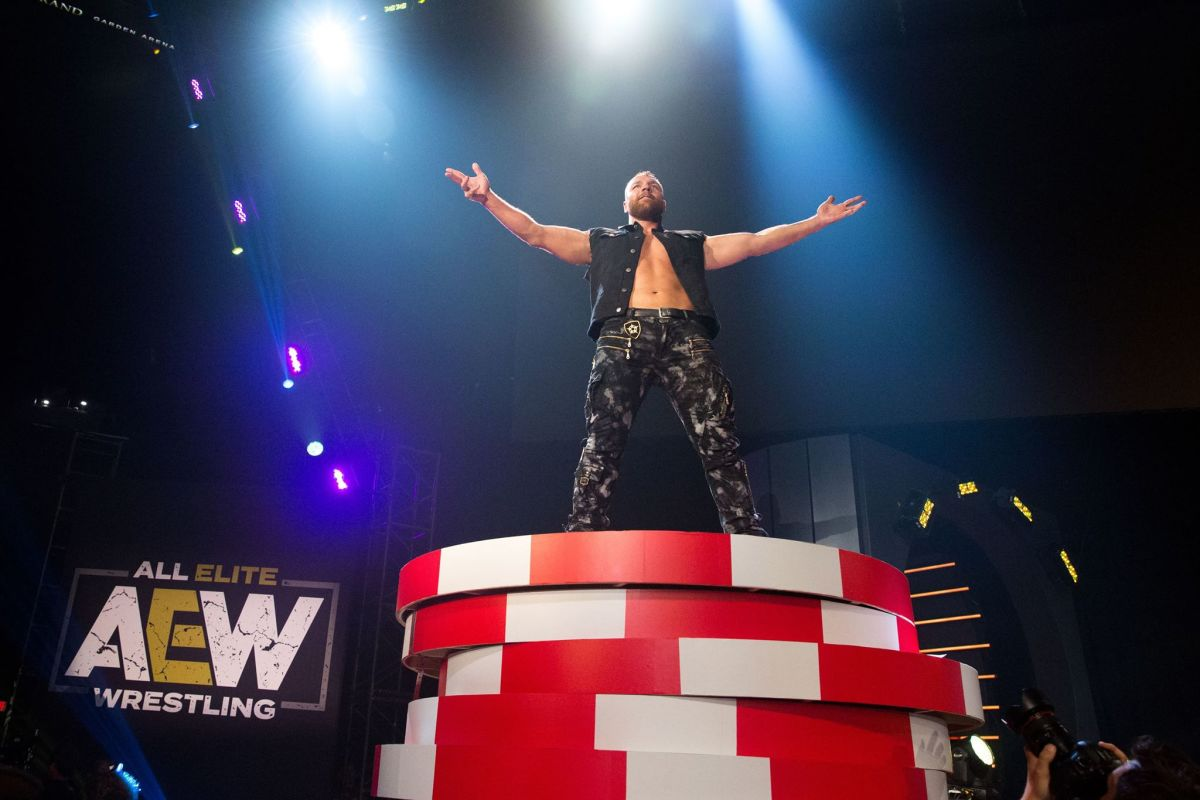Jon Moxley stands on top of the world Photo Credit AEW