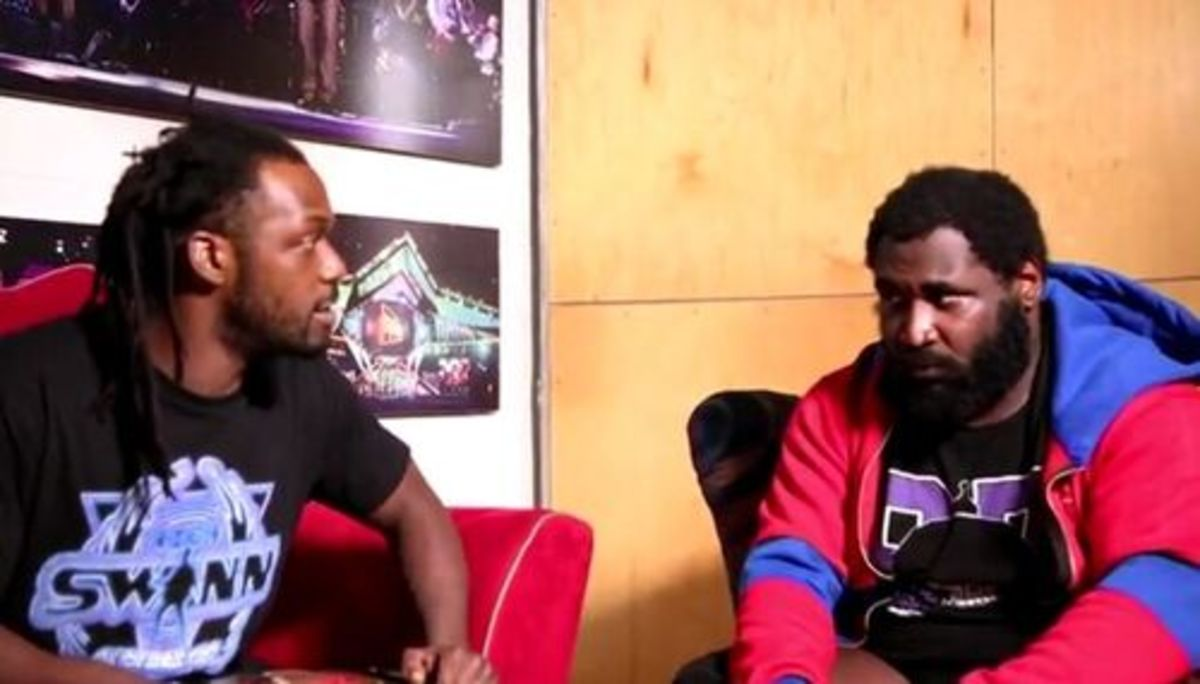 Red LOCA brand tracksuit worn by Willie Mack on the right